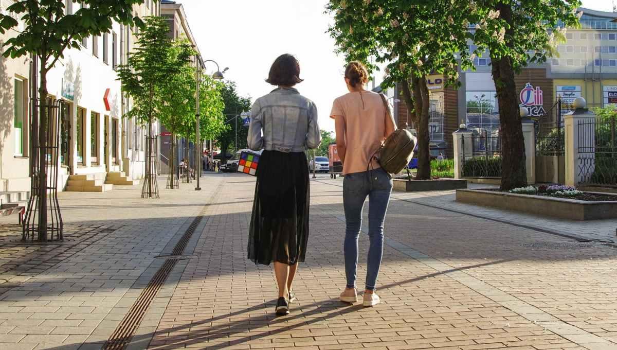 photo of women walking down the street
