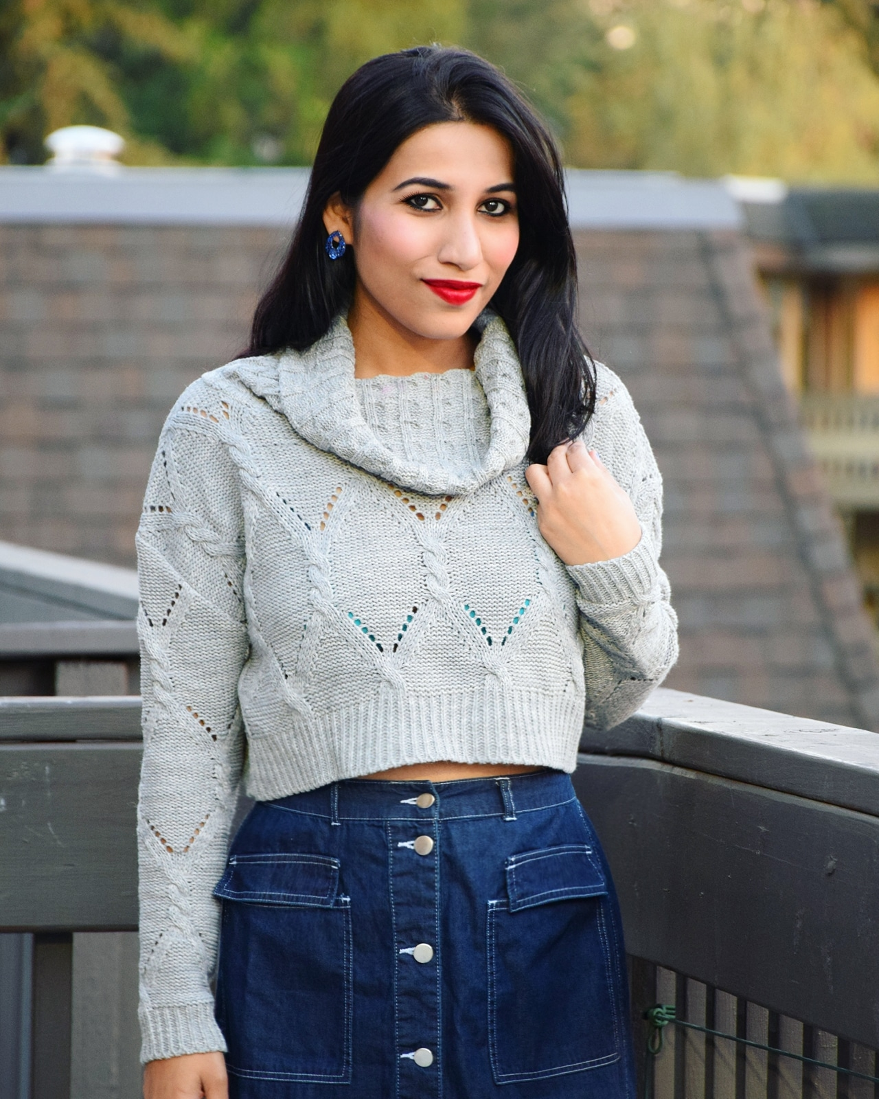 https://femmeluxefinery.co.uk/collections/knit-jumper/products/grey-polo-neck-cable-knit-cropped-jumper-juniper